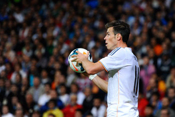 Hi-res-182580815-gareth-bale-of-real-madrid-cf-holds-the-ball-during-the_display_image
