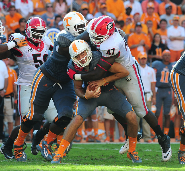 Hi-res-183174755-justin-worley-of-the-tennessee-volunteers-is-sacked-by_crop_650