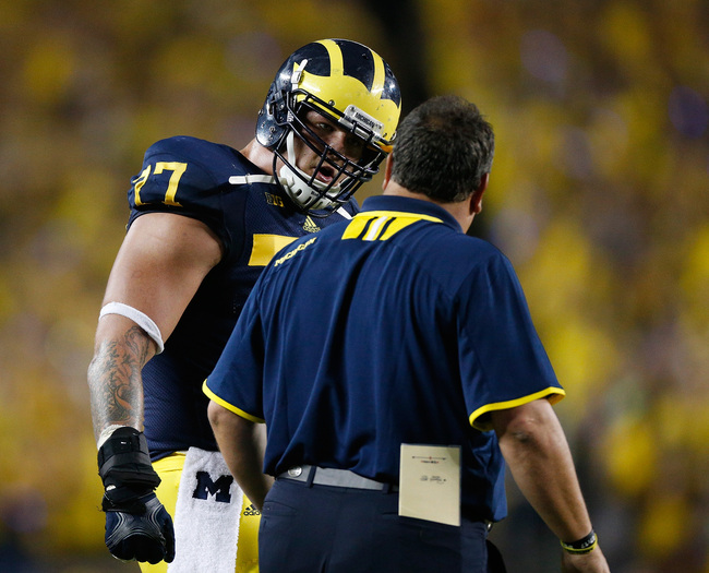 Hi-res-181935716-head-coach-brady-hoke-talks-with-taylor-lewan-of-the_crop_650