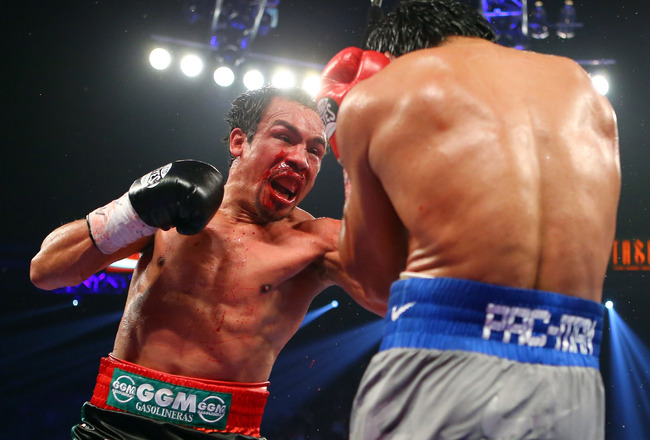 Hi-res-158016806-juan-manuel-marquez-throws-a-left-at-manny-pacquiao_crop_650x440