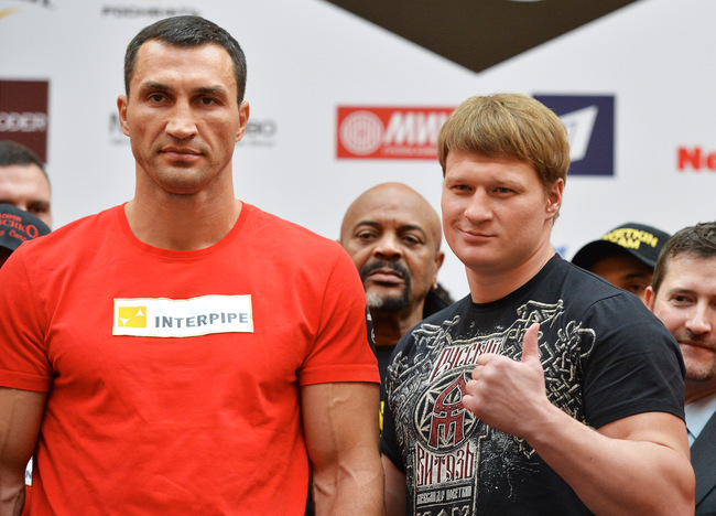 Hi-res-183093422-wladimir-klitschko-and-alexander-povetkin-pose-during_crop_650