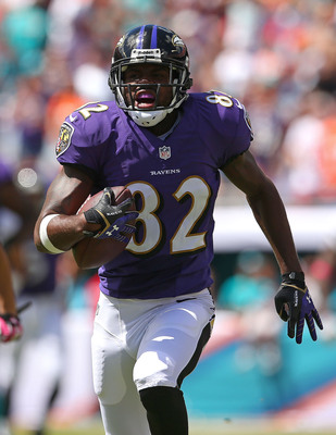 Hi-res-183447309-torrey-smith-of-the-baltimore-ravens-runs-after-a-catch_display_image