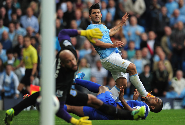 Hi-res-183153403-sergio-aguero-of-manchester-city-shoots-past-sylvain_crop_650x440
