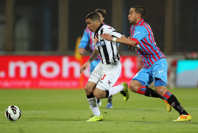 Hi-res-163802023-giuseppe-bellusci-of-catania-competes-for-the-ball-with_crop_650