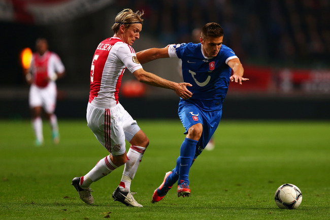 Hi-res-153054671-christian-poulsen-of-ajax-and-dusan-tadic-of-twente_crop_650