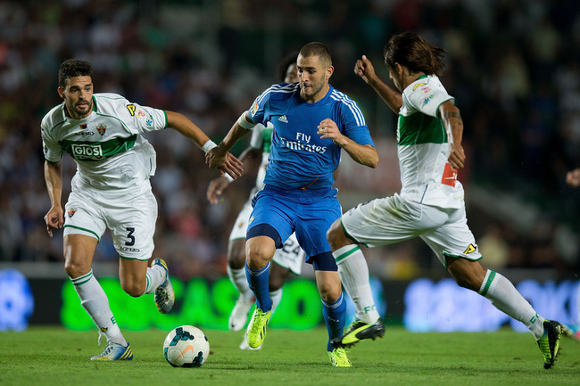 Hi-res-181809372-karim-benzema-of-real-madrid-cf-competes-for-the-ball_crop_650