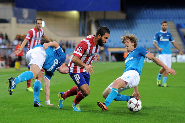 Hi-res-180963801-arda-turan-of-club-atletico-de-madrid-battles-for-the_crop_650