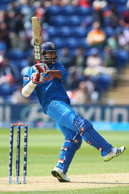 Hi-res-170021578-shikhar-dhawan-of-india-pulls-to-the-legside-during-the_display_image