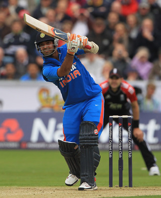 Hi-res-123430960-ajinkya-rahane-of-india-hits-the-ball-towards-the_display_image