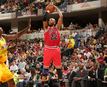 Hi-res-183187328-taj-gibson-of-the-chicago-bulls-shoots-against-the_display_image