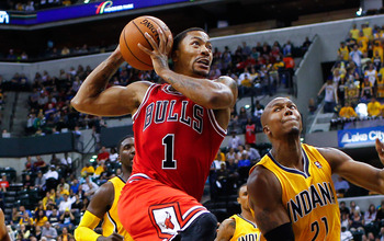 Hi-res-183192816-derrick-rose-of-the-chicago-bulls-takes-the-ball-to-the_display_image