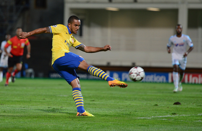Hi-res-180963796-theo-walcott-of-arsenal-scores-his-goal-during-the-uefa_crop_650
