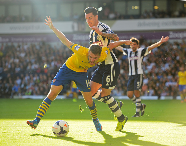 Hi-res-183440923-aaron-ramsey-of-arsenal-battles-with-liam-ridgewell-of_crop_650