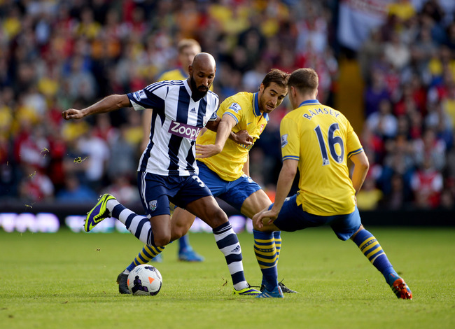 Hi-res-183436055-nicolas-anelka-of-west-bromwich-albion-battles-with_crop_650