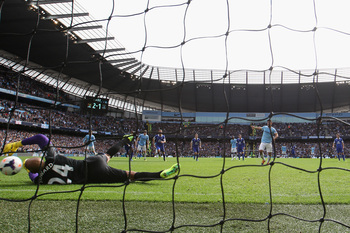 Hi-res-183151597-sergio-aguero-of-manchester-city-scores-from-a-penalty_display_image