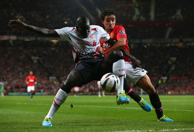 Hi-res-181800340-rafael-of-manchester-united-competes-with-mamadou-sakho_crop_650