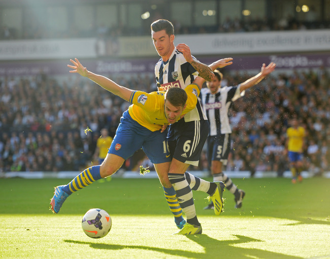 Hi-res-183440830-aaron-ramsey-of-arsenal-battles-with-liam-ridgewell-of_crop_650