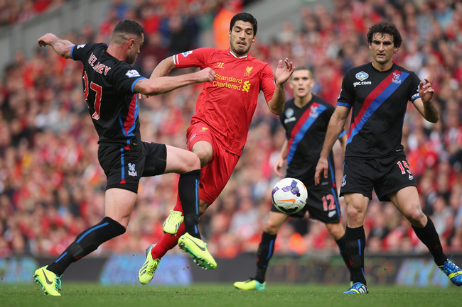 Hi-res-183158443-luis-suarez-of-liverpool-in-action-with-damien-delaney_crop_650