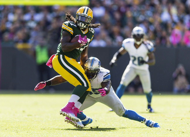Hi-res-183447615-eddie-lacy-of-the-green-bay-packers-tries-to-spin-away_crop_650