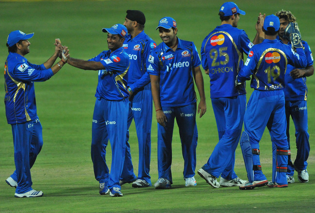Hi-res-154120577-mumbai-players-celebrate-capturing-the-wicket-of-alviro_crop_650x440