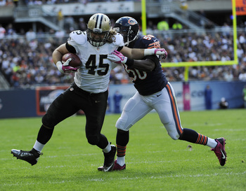 Hi-res-183452910-jed-collins-of-the-new-orleans-saints-is-tackled-by_display_image