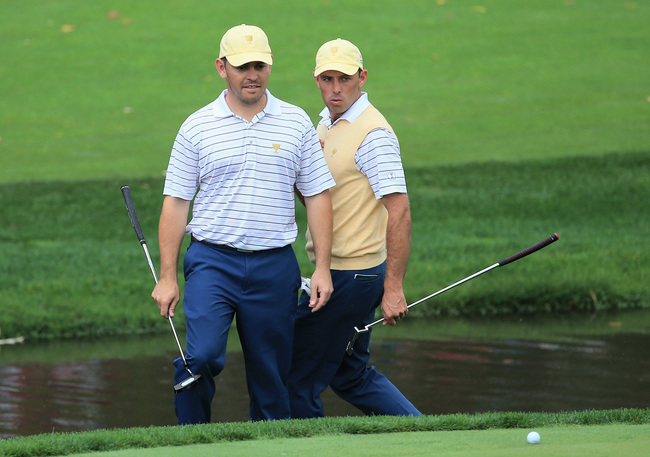 Hi-res-183174798-louis-oosthuizen-and-charl-schwartzel-of-south-africa_crop_650
