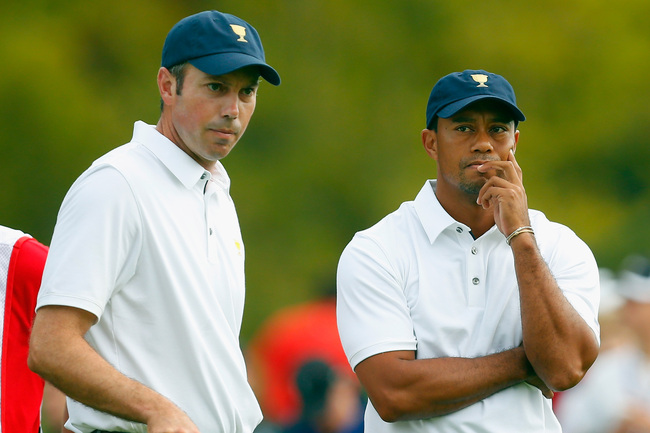 Hi-res-183395181-tiger-woods-and-matt-kuchar-of-the-u-s-team-stand-on_crop_650
