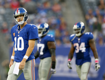 Hi-res-183457401-eli-manning-of-the-new-york-giants-walks-off-the-field_display_image