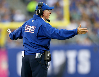 Hi-res-183457367-head-coach-tom-coughlin-of-the-new-york-giants-reacts_display_image