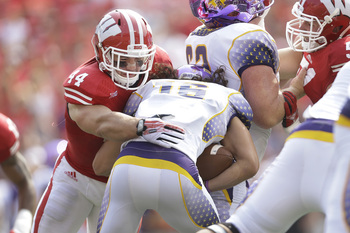 Hi-res-179877562-chris-borland-of-the-wisconsin-badgers-tackles-zack_display_image