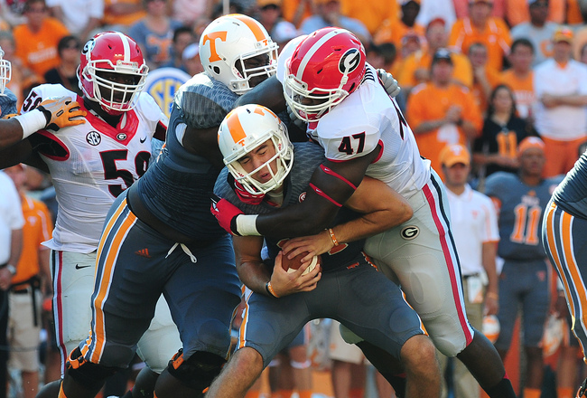 Hi-res-183174755-justin-worley-of-the-tennessee-volunteers-is-sacked-by_crop_650x440