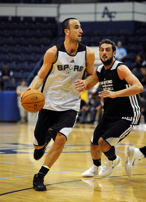 Hi-res-182996247-manu-ginobili-drives-to-the-basket-against-marco_display_image