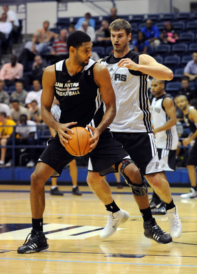 Hi-res-182996249-tim-duncan-drives-to-the-basket-against-tiago-splitter_display_image