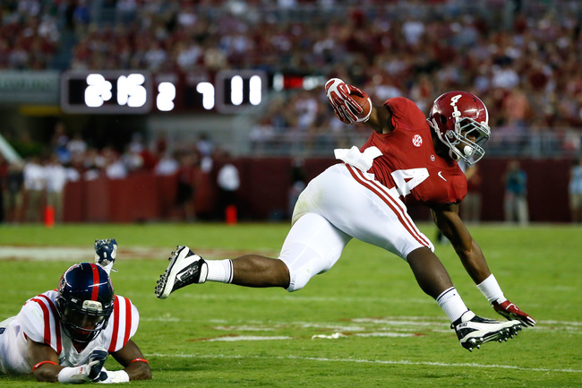 Hi-res-182254283-yeldon-of-the-alabama-crimson-tide-leaps-over-mike_crop_650