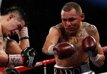 Hi-res-165116633-mike-alvarado-lands-a-right-to-the-head-of-brandon-rios_display_image