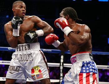 Hi-res-167683269-peter-quillin-punches-fernando-guerrero-during-the-wbo_display_image