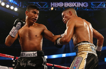 Hi-res-170642237-mikey-garcia-connects-with-a-left-to-the-face-of-juan_display_image