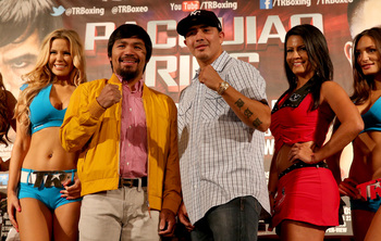 Hi-res-175801205-manny-pacquiao-and-brandon-rios-pose-with-ring-girls-at_display_image