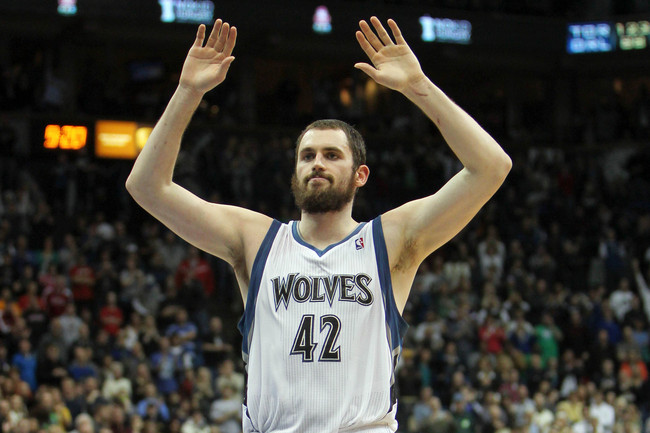 Dec 29, 2012; Minneapolis, MN, USA; Minnesota Timberwolves forward Kevin Love (42) celebrates a play during the fourth quarter against the Phoenix Suns at the Target Center. The Timberwolves defeated the Suns 111-107. Mandatory Credit: Brace Hemmelgarn-US