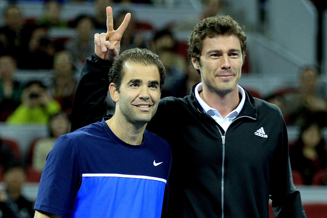 Hi-res-127679022-pete-sampras-of-the-united-states-and-marat-safin-of_crop_650