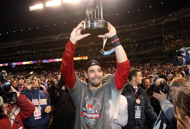 Hi-res-77544178-mike-lowell-of-the-boston-red-sox-holds-the-mvp-trophy_crop_650x440