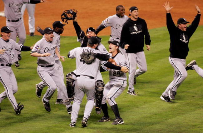 56019003-catcher-a-j-pierzynski-hugs-pitcher-bobby-jenks-as-they_crop_650