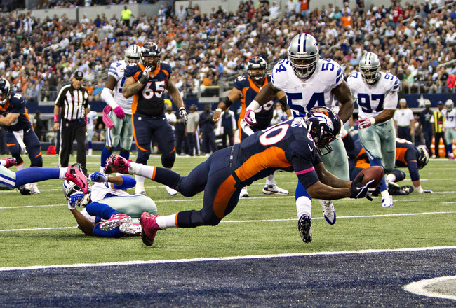 Hi-res-183472393-julius-thomas-of-the-denver-broncos-dives-over-the-goal_crop_650x440