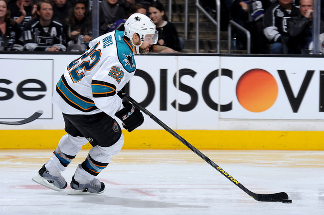 Hi-res-169604440-dan-boyle-of-the-san-jose-sharks-skates-with-the-puck_crop_650