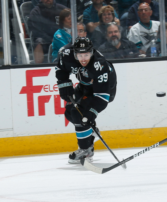 Hi-res-169594869-logan-couture-of-the-san-jose-sharks-passes-the-puck_crop_650