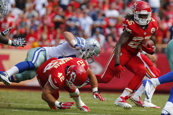 Hi-res-180892201-jamaal-charles-looks-for-a-running-lane-as-anthony_display_image