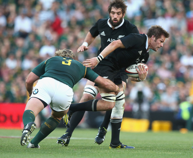 Hi-res-183167395-richie-mccaw-of-the-all-blacks-is-tackled-by-jannie-du_crop_650