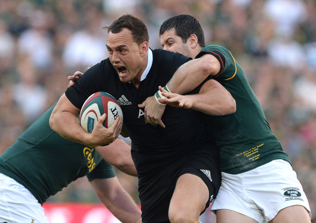 Hi-res-183167012-aaron-cruden-of-new-zealand-gets-tackled-by-morne-steyn_crop_650