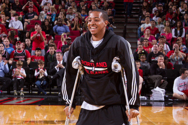 Hi-res-183592806-mccollum-of-the-portland-trail-blazers-smiles-during_crop_650
