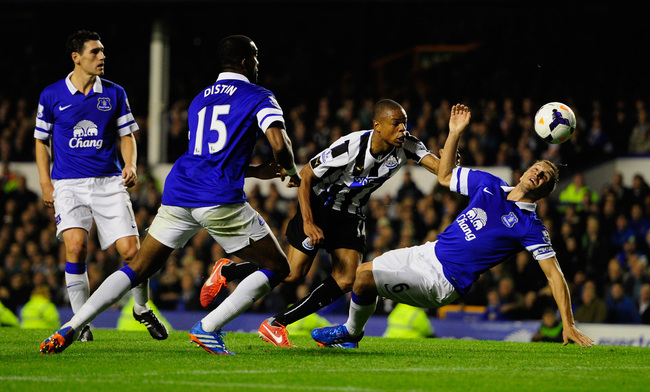 Hi-res-182554372-newcastle-player-loic-remy-beats-phil-jagielka-to-score_crop_650